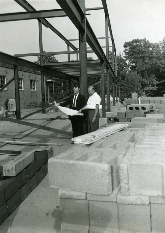 Image: Kurt Landsberger & architect looking at plans for the Pequannock NJ building